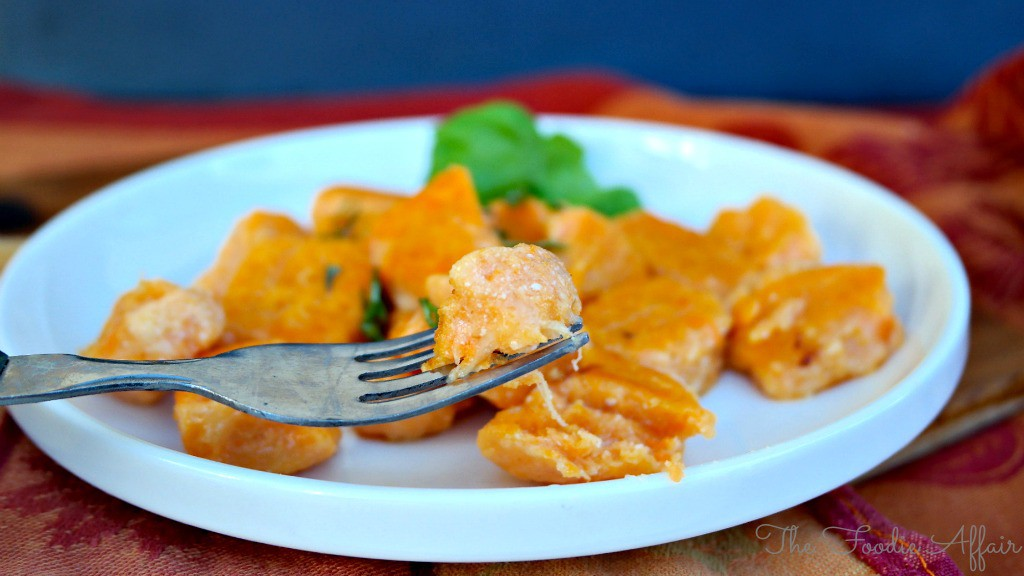 Sweet Potato Gnocchi on a white plate ready to be eaten.