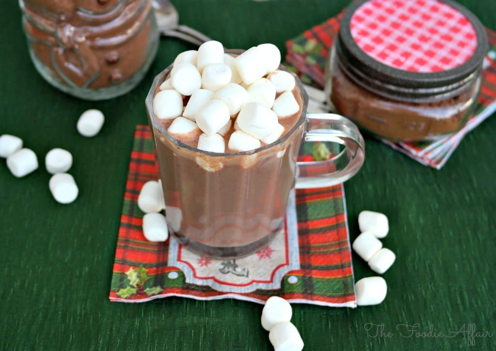 Clear cup of hot cocoa mix recipe topped with marshmallows