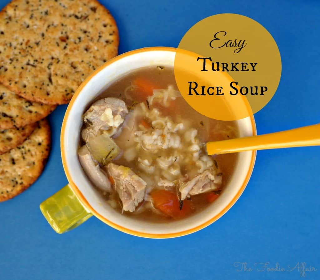 Easy turkey rice soup recipe in a white mug with a yellow spoon