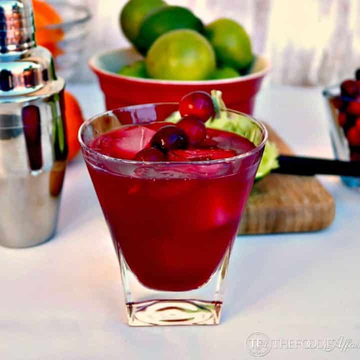 Cranberry Cosmopolitan in a clear glass with lime