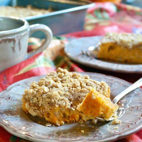 coffee cake made with sweet potatoes on a tan plate