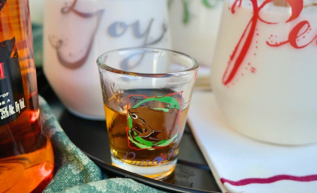 Rum in a small shot glass to add to coquito cocktail