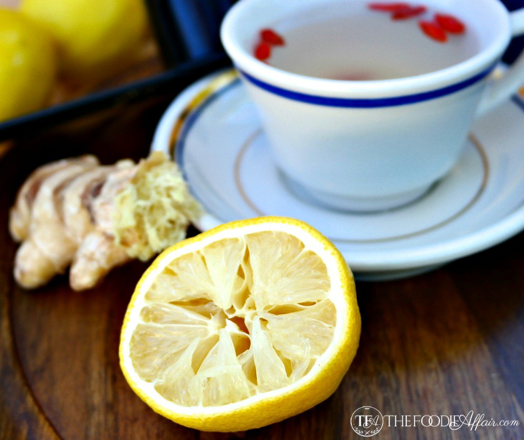 a teacup of lemon ginger detox tea with fresh squeezed lemon
