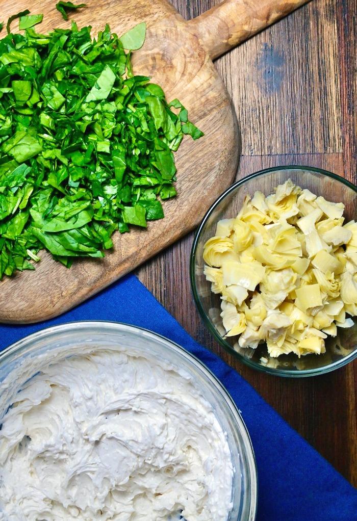 Ingredients for fresh spinach artichoke dip recipe.