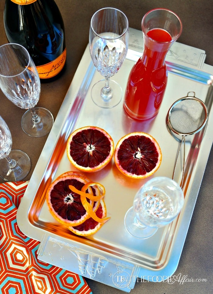 Blood Orange French 75 recipe ingredients on a silver platter