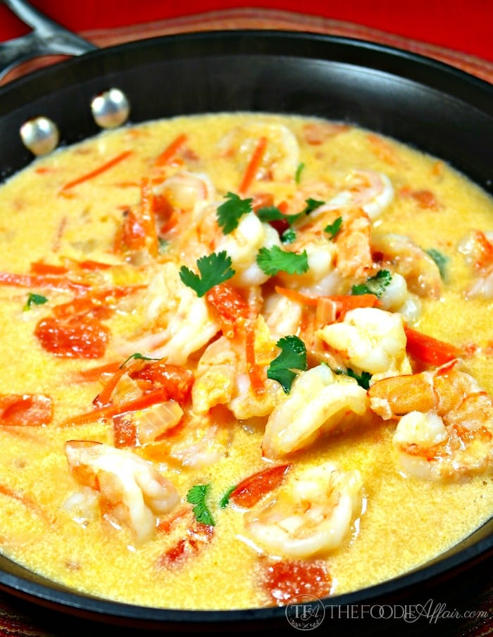Easy Shrimp in Coconut Sauce simmering in a black skillet