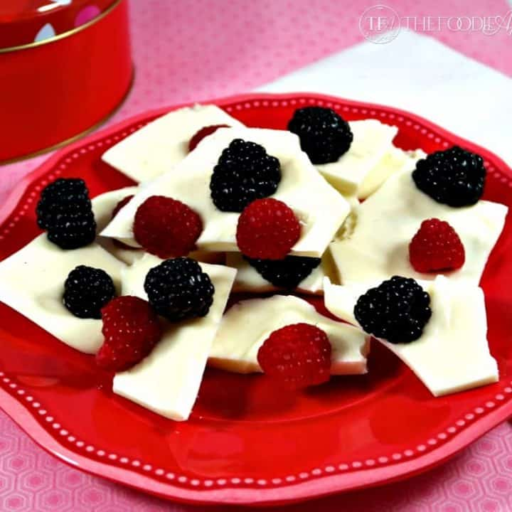 Fresh Berry White Chocolate Bark on a red plate