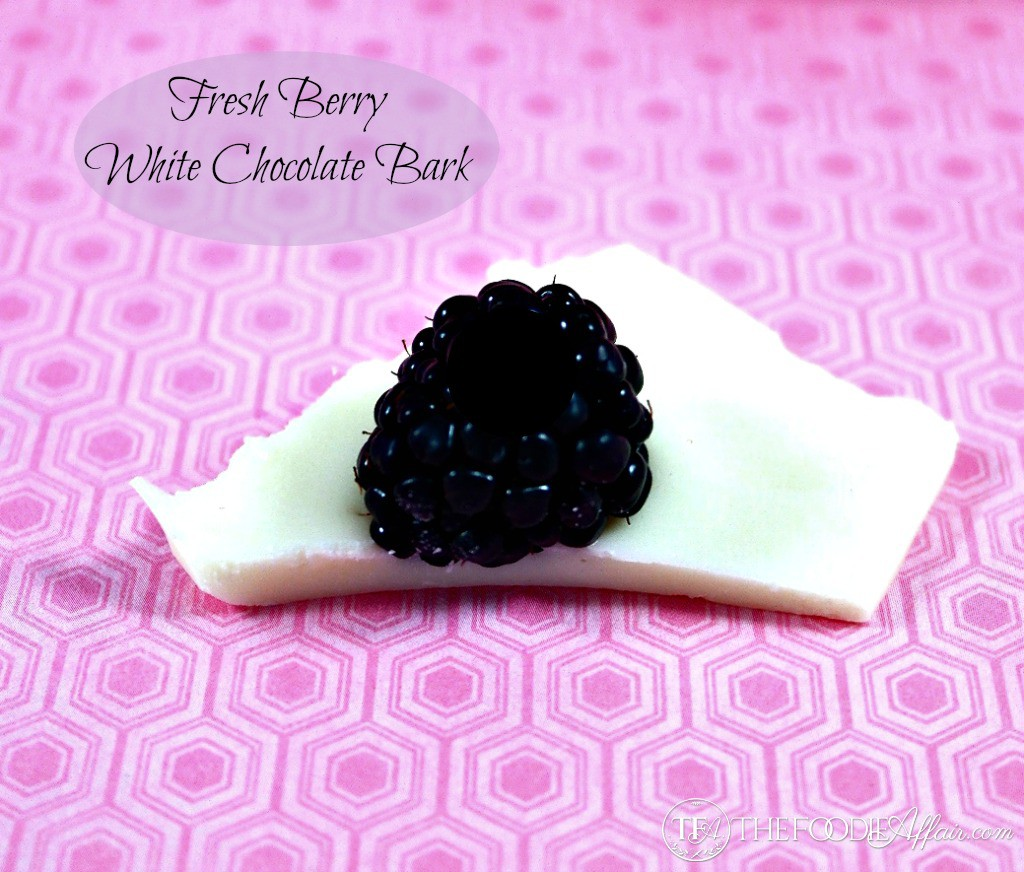 A piece of White Chocolate Bark topped with a blackberry