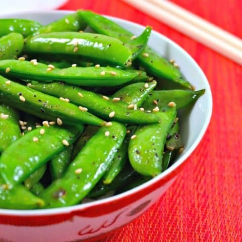 Sugar snap peas in a white and red bowl