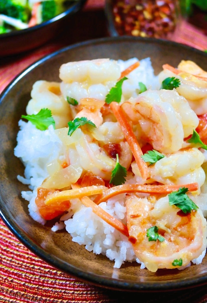 Shrimp in coconut sauce over white rice and topped with cilantro