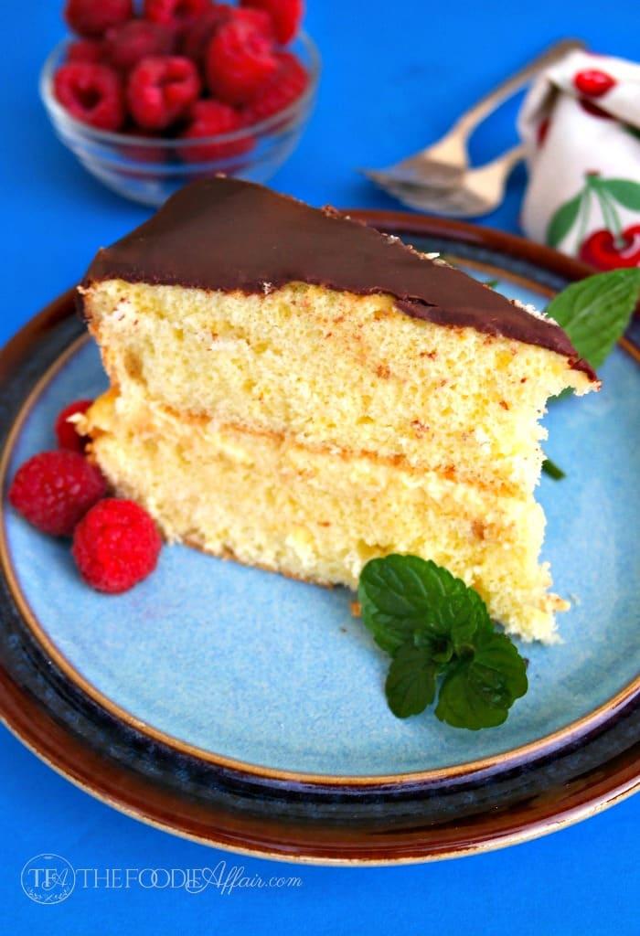 Slice of Boston cream pie on a blue plate