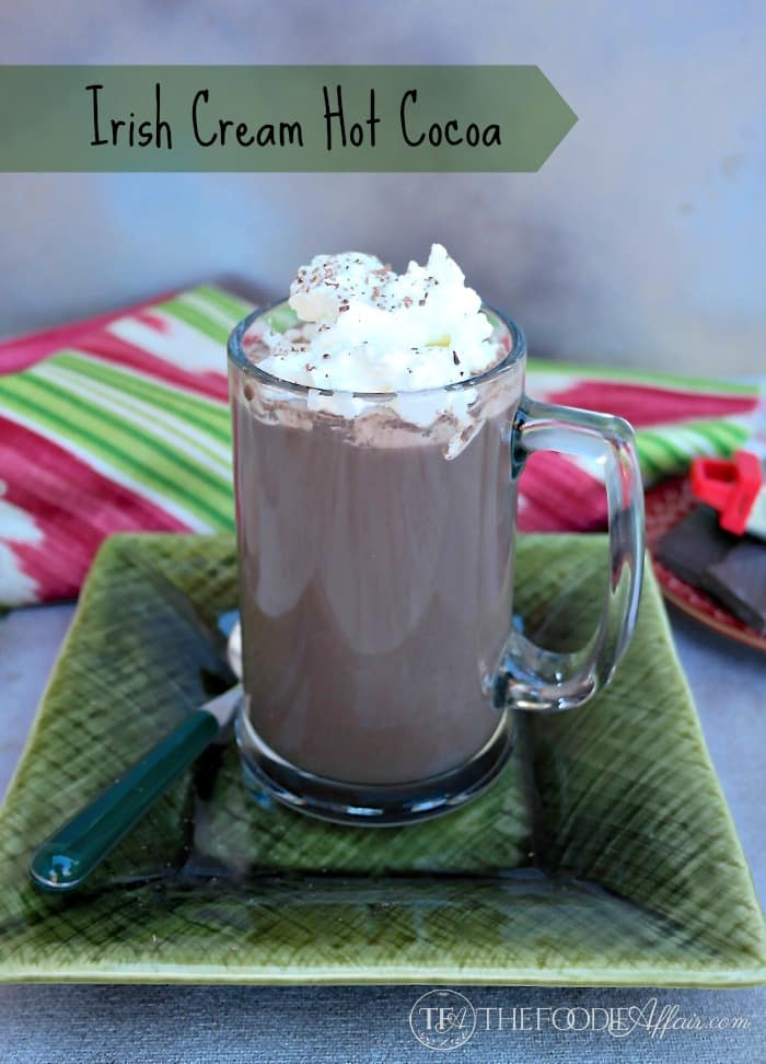 Irish cream hot chocolate with whipped cream in a clear mug