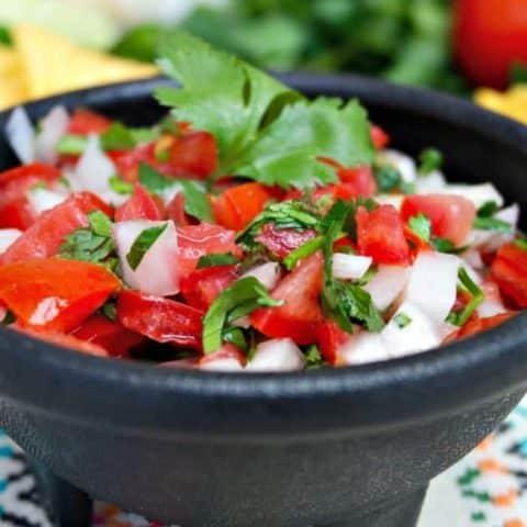 Pico de Gallo a fresh salsa in a black serving bowl