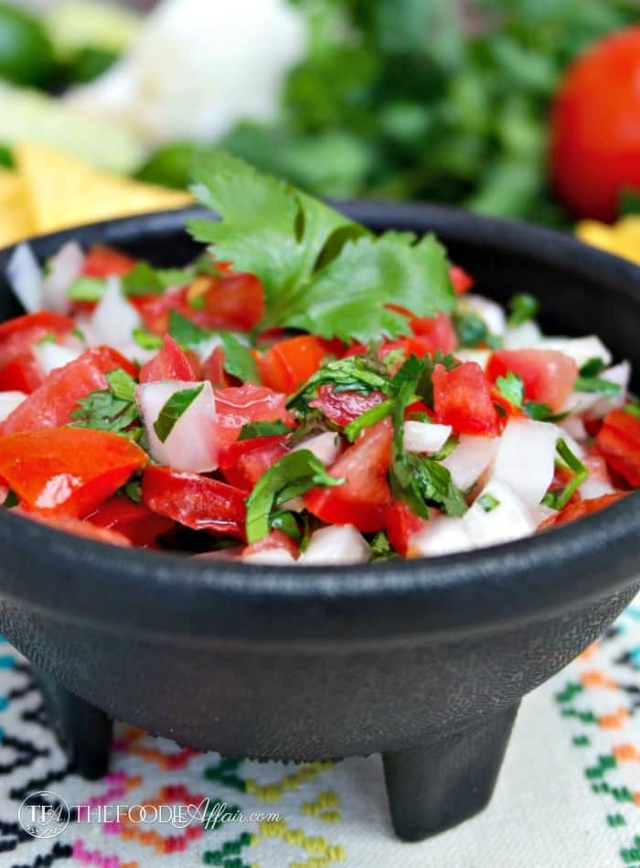 Pico de Gallo a fresh salsa in a black serving bowl