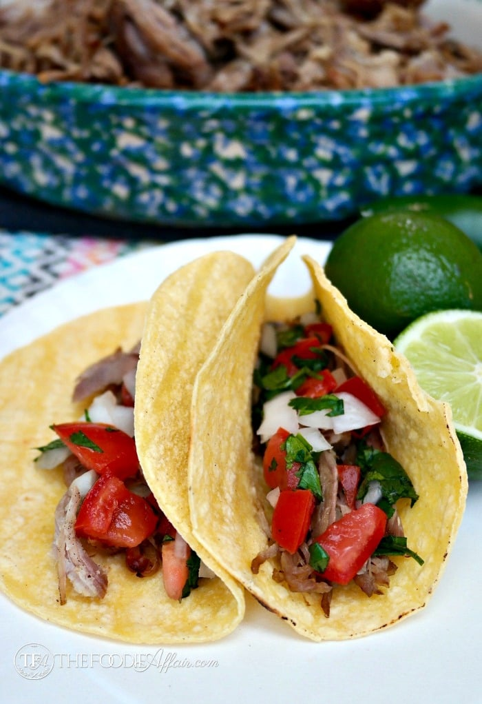Slow Cooker Pork Carnitas in a corn tortilla topped with fresh salsa