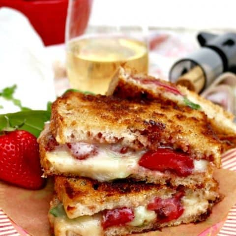 Strawberry Balsamic Brie Grilled Cheese on a striped pink plate