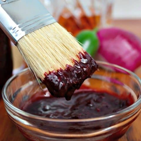 Blueberry Bourbon Barbecue Sauce with a basting brush