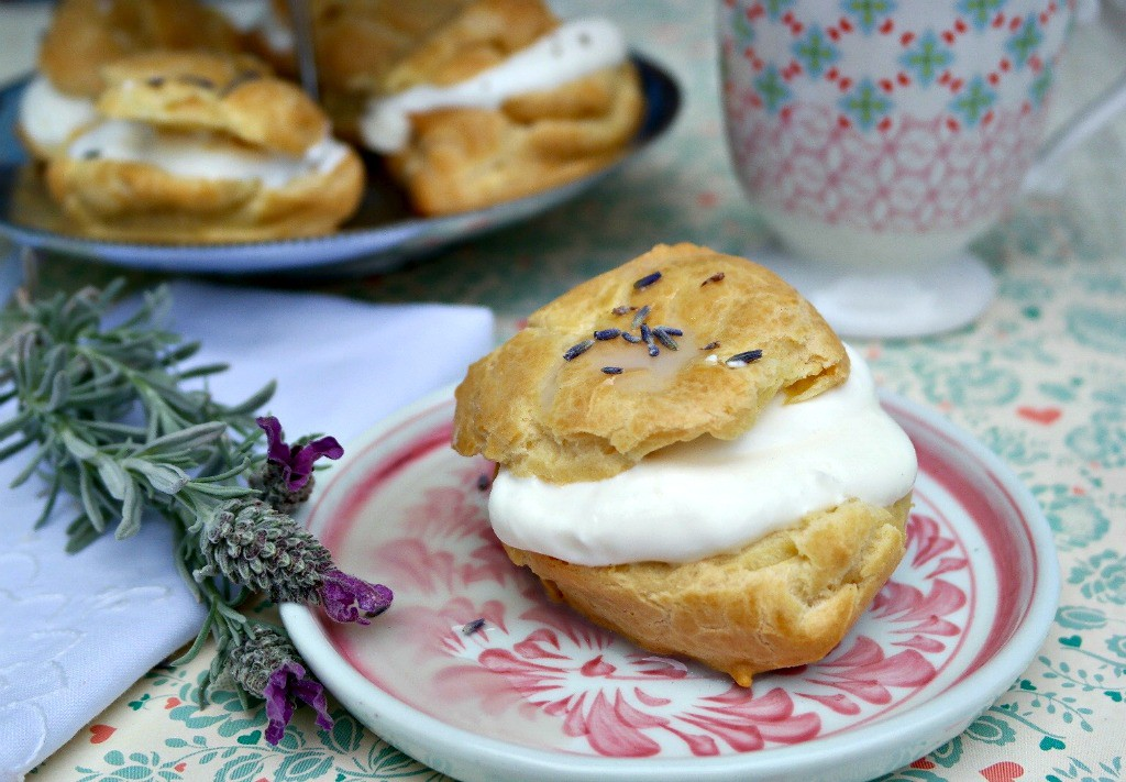Lavender Cream Puffs filled with whipped cream and topped with a lavender glaze - The Foodie Affair
