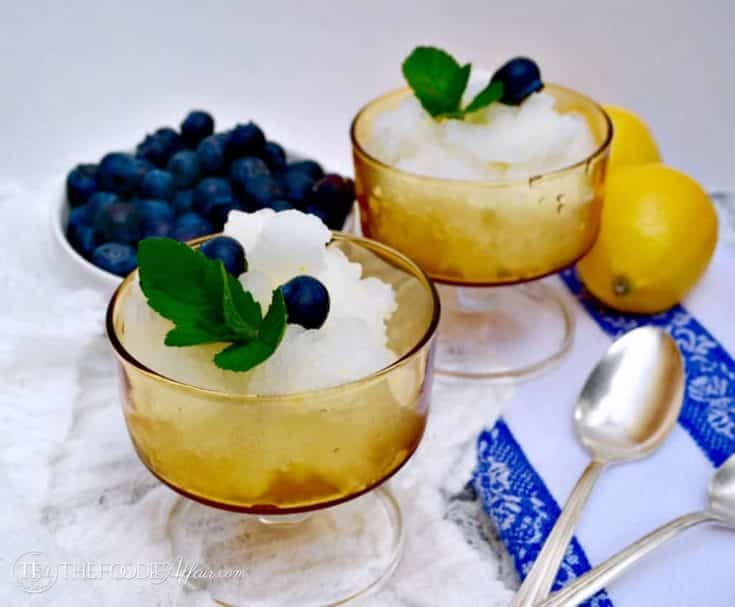 Lemon Ice in a yellow serving dish with blueberries
