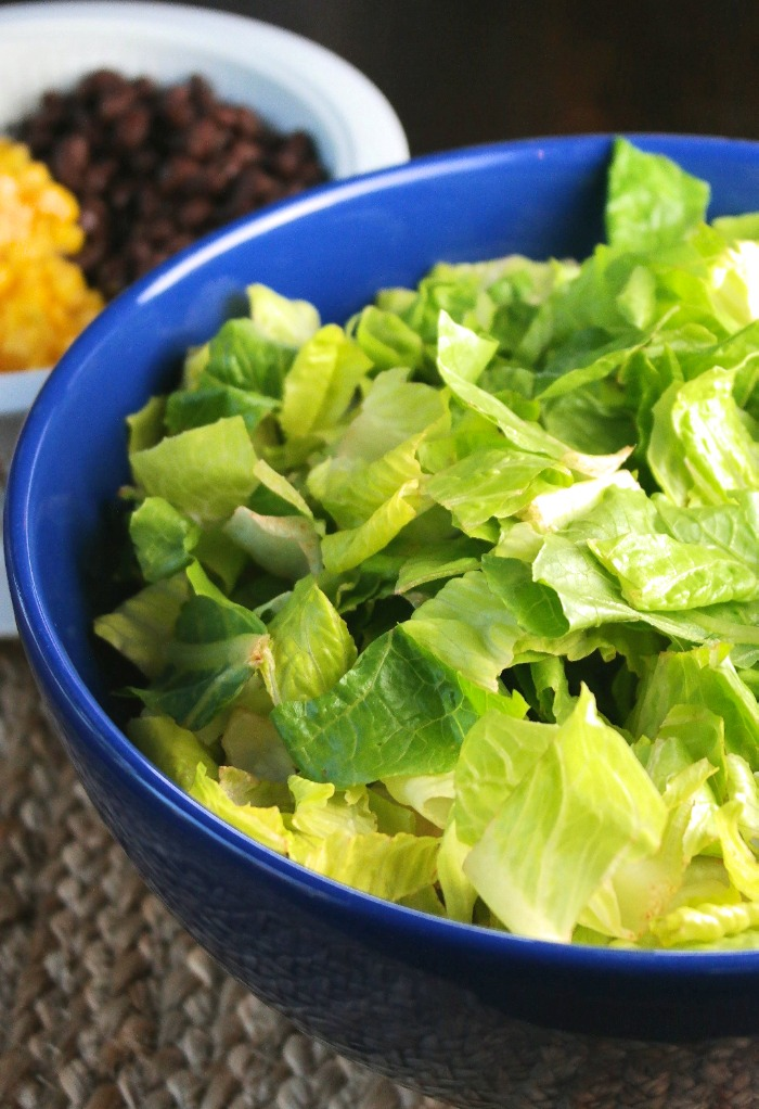 Bite size lettuce in a blue bowl