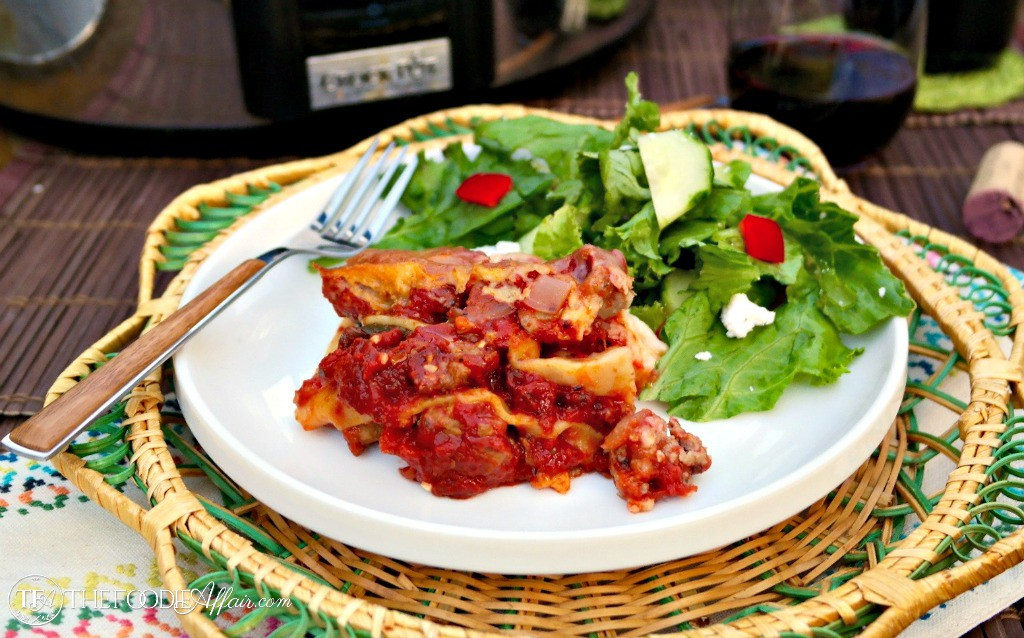 Easy lasagna made with no boil noodles and cooked in a slow cooker - The Foodie Affair