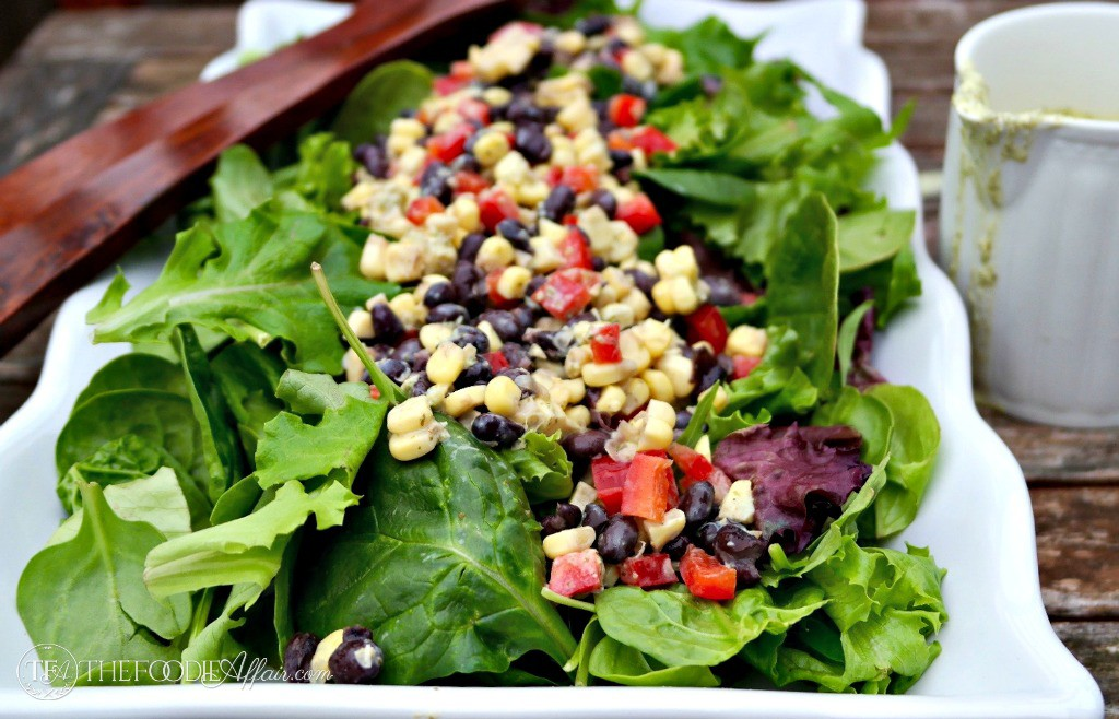 Black Bean and Corn Salad with a yogurt cilantro dressing on a white platter
