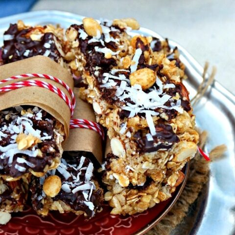 Layered dark chocolate, coconut and nuts bars