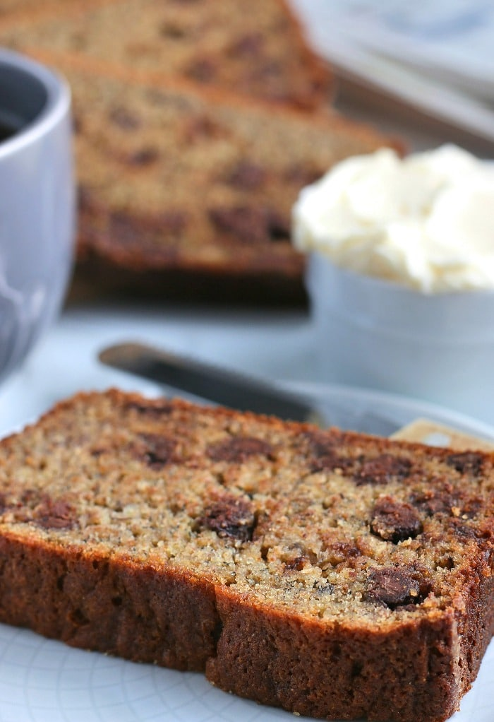 Here we see a slice of the delicious banana bread with chocolate chips ready to be enjoyed.