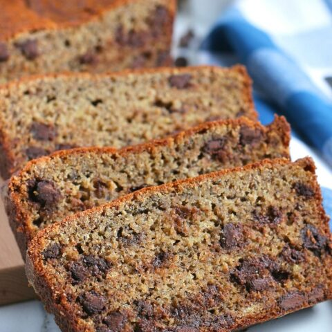 Here we see a few slices of the banana bread with chocolate chips stacked up and ready to be shared.