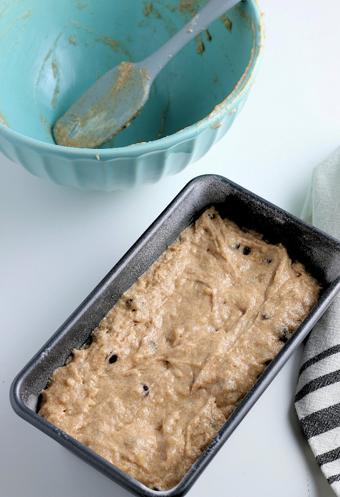 Now the batter is in the loaf pan and ready to be baked into our perfect chocolate chip banana bread recipe.