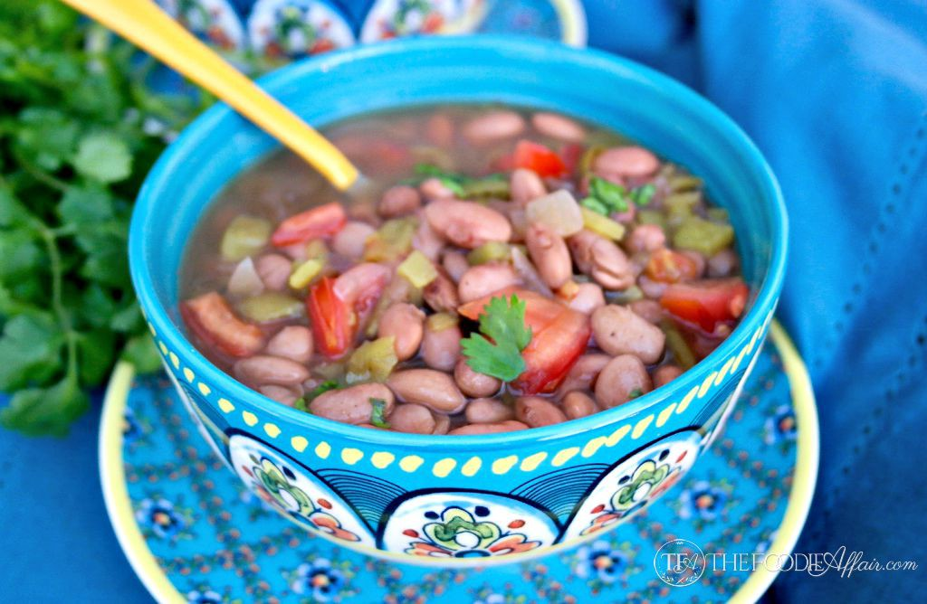 Mexican pinto beans crock pot recipe in a teal bowl
