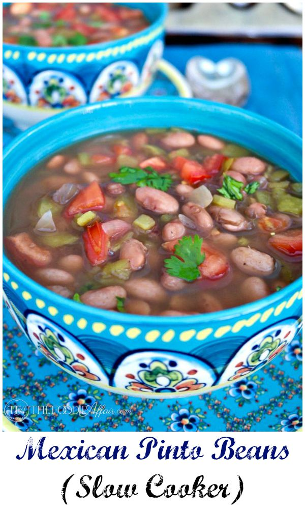 Tasty Mexican Pinto Beans slow cooked with flavor spices and fresh chopped tomatoes. Serve this as a main dish or a side to your favorite Latin meal! The Foodie Affair