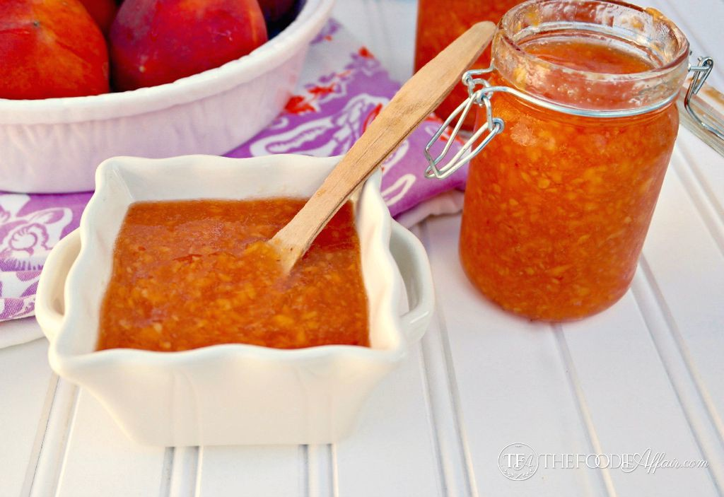 peach freezer jam in a white bowl and glass mason jar
