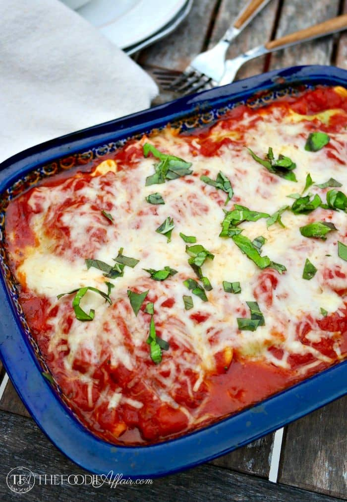 Ravioli Lasagna in a small blue baking dish