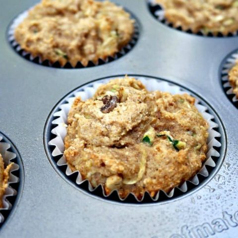 protein muffins with zucchini and walnuts in a baking tin