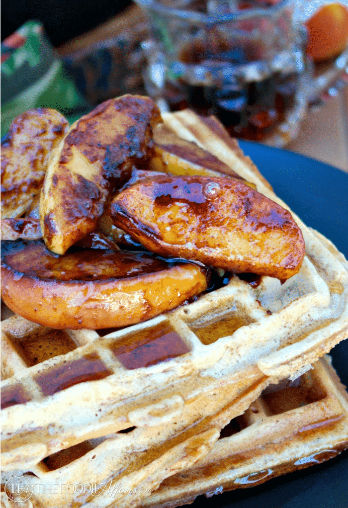 Close up waffles topped with apples.
