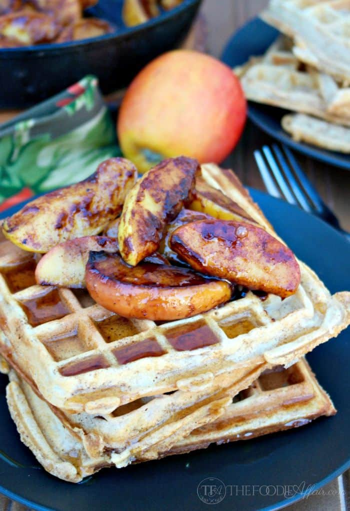 Plate of whole wheat waffles topped with cooked apples.