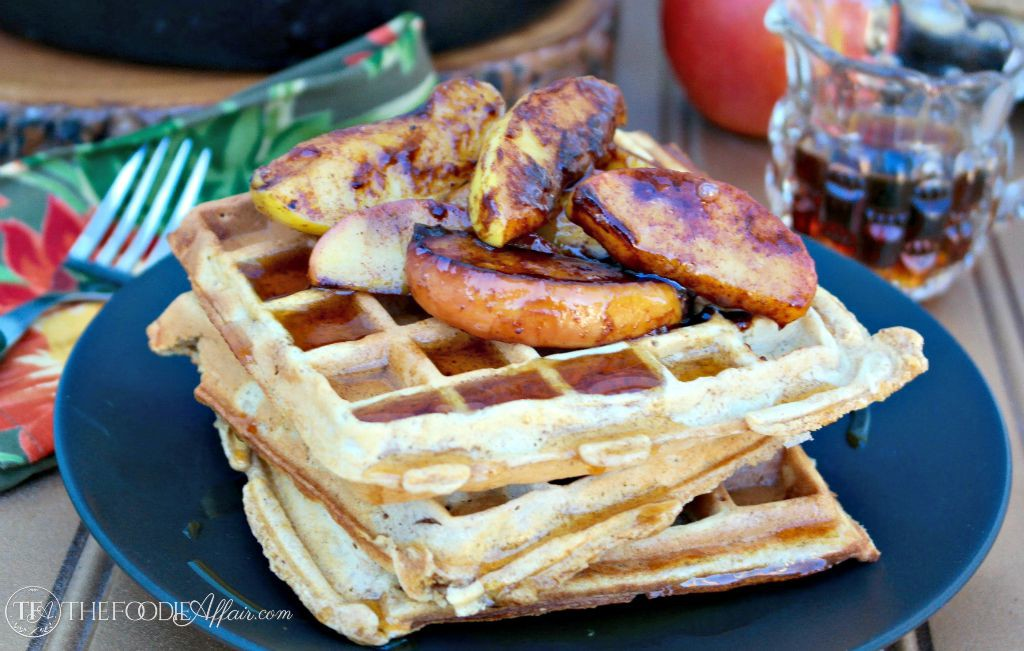 Apple Spice Waffles made with whole wheat and fresh grated apples topped with pan fried caramelized apples. The Foodie Affair