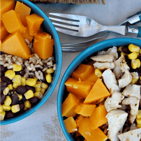 Healthy Quinoa Burrito Bowl layered with Butternut squash, black beans, corn and chicken.