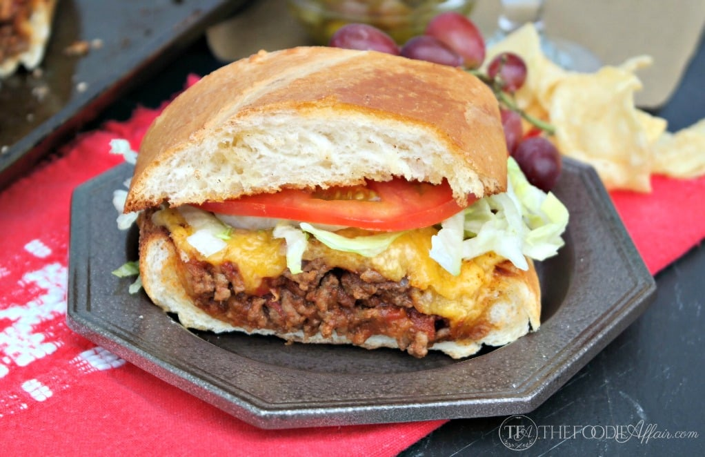 This Bacon Cheeseburger Stuffed French bread is packed with a flavorful beef mixture and then topped with a gooey layer of cheese! Add additional condiments for a full burger experience! The Foodie Affair