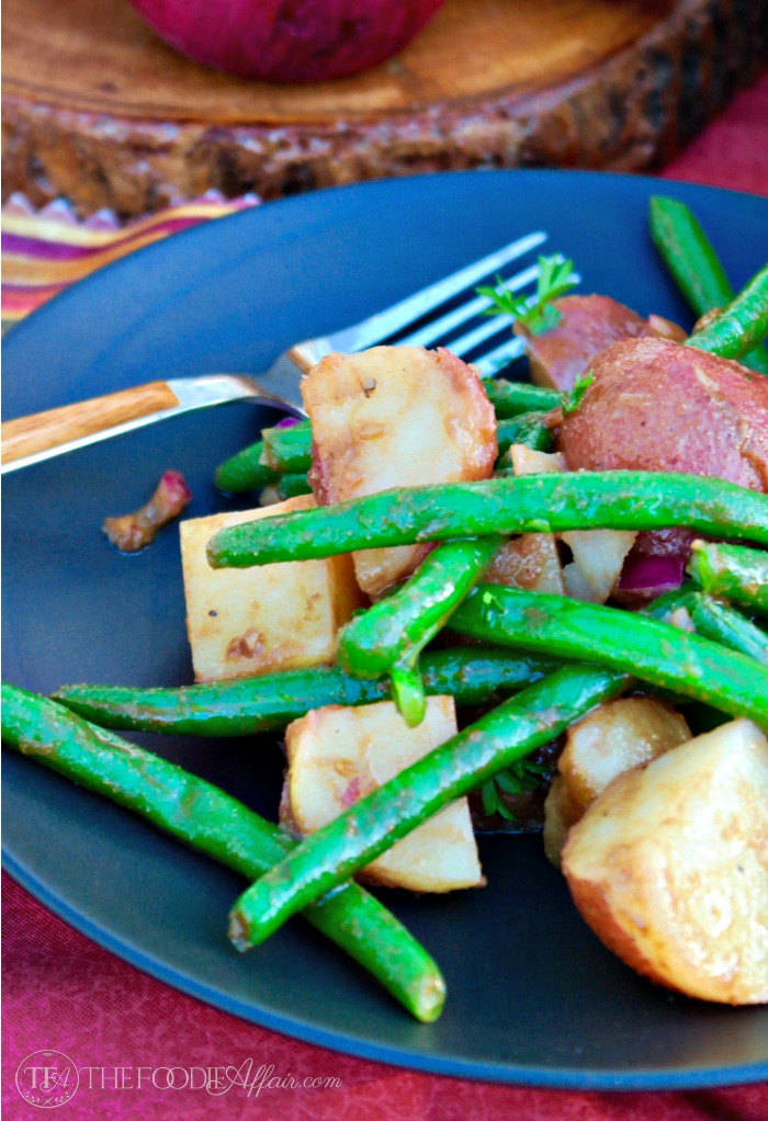 green bean potato salad on a black plate