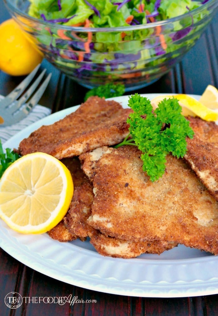 Easy German Pork Schnitzel made with thin slices of pork and dipped in a flour, egg, and breadcrumb coating before lightly frying! The Foodie Affair