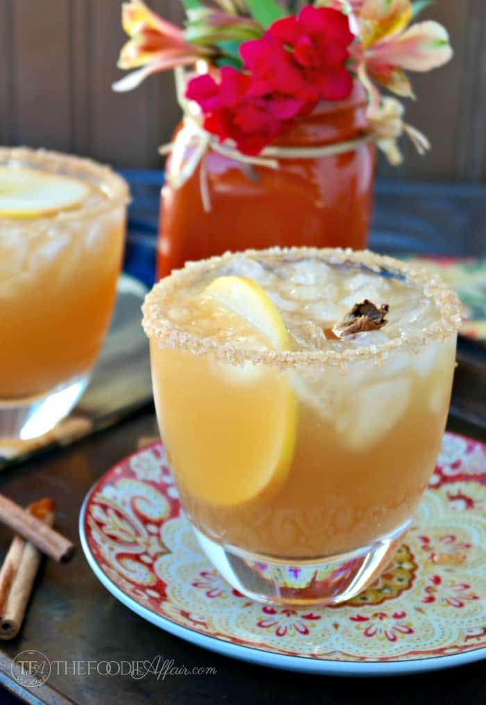 Cozy up with an Apple Cider Margarita this Fall! This classic cocktail is a delicious mix of tequila, orange liquor and apple cider. The Foodie Affair
