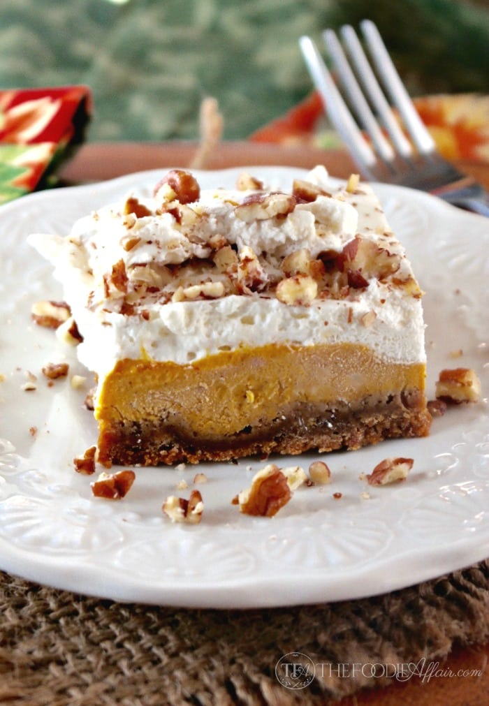 Light and airy pumpkin delight dessert is three layers of delicious flavors of gingersnap crust, creamy pumpkin filling and fresh whipped cream! The Foodie Affair