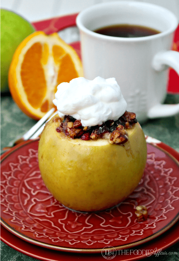 whipped cream on top of a baked apple