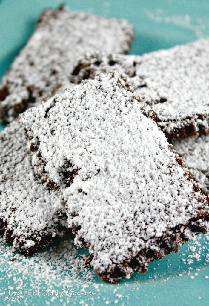 These Chocolate Shortbread Snow Cookies will melt in your mouth! Rich chocolate, light and tender sprinkled with powdered sugar snow! The Foodie Affair