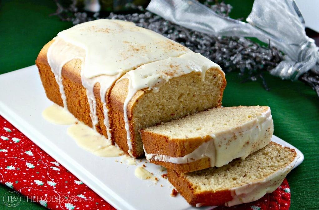 sliced eggnog bread on a white serving plate