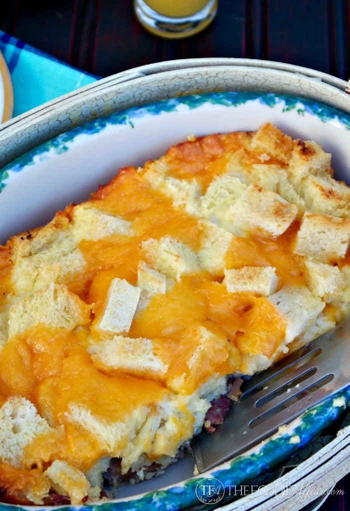 Gooey cheesy overnight ham egg casserole is sure to please a crowd! Make this a day ahead for easy entertaining! The Foodie Affair