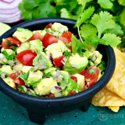 avocado dip in a small black salsa dish