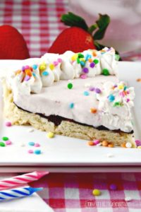 Shortbread Ice Cream Cookie Cake has a think layer of chocolate separating the crust from the ice cream! This tasty dessert can be sliced and eaten with your hands! The Foodie Affair